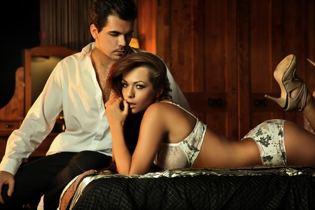 Sexy couple in bedroom Stock Photo - 9336839