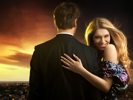 Conceptual portrait of a young couple in elegant evening dresses Stock Photo - 9468278