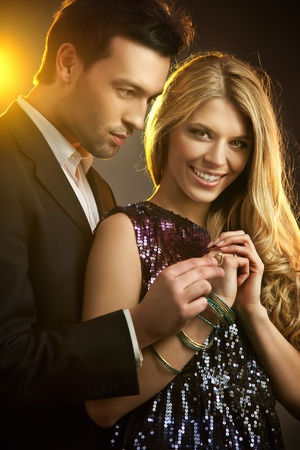 Happy young man gifting a ring to a beautiful young woman  photo
