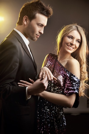 Happy young man gifting a ring to a beautiful young woman Stock Photo - 9469096