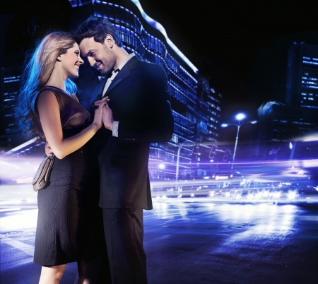 Handsome young couple dancing on the street and smiling Stock Photo - 9468295