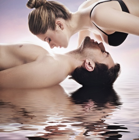 Conceptual portrait of a young couple in spa photo