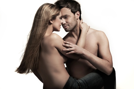 nude male: Young couple in blue jeans on white background Stock Photo