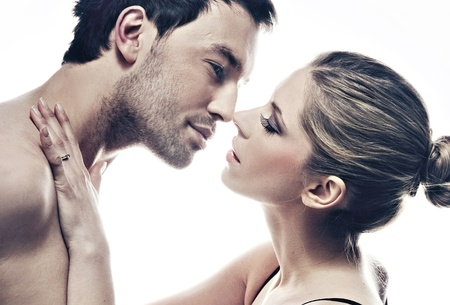 portrait of handsome couple gently kissing Stock Photo - 9467962