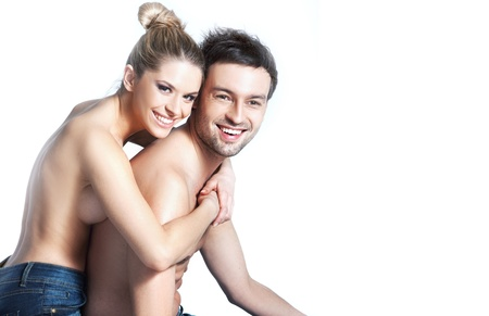 Young couple in blue jeans on white background Stock Photo