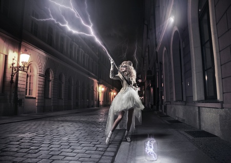 Stylish woman catching thunderbolts photo