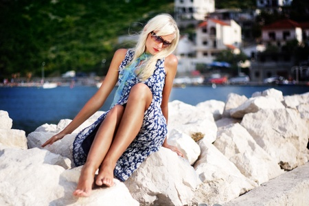 Pretty blonde woman relaxing near the water Stock Photo - 9343166