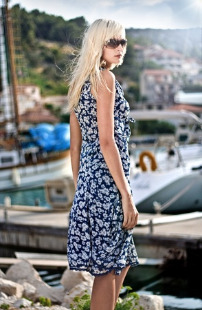 Attractive young woman near the yachts Stock Photo - 9343295