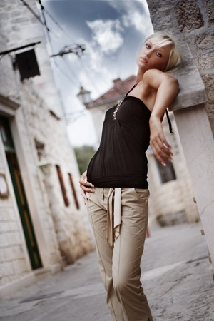 Amaizing blonde woman on the street in vacation day photo