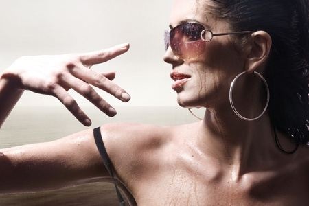 brunette portrait with sunglasses photo