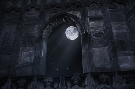 moody: Full moon seen through the window of the old castle
