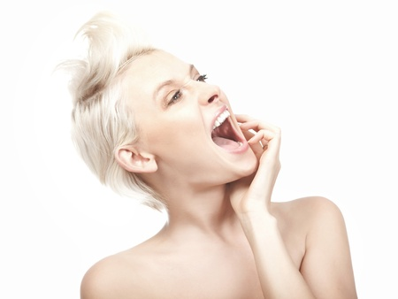 Young blond woman crazily screaming photo