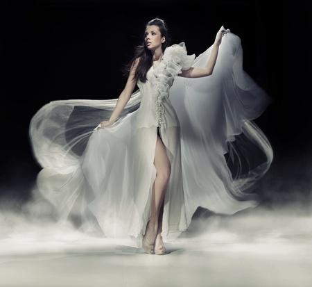 Sensual brunette woman in white dress photo