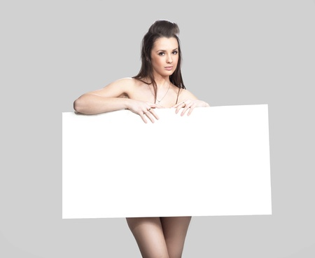 lingerie young: Pretty girl holding a white message board Stock Photo
