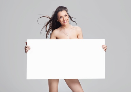 white women: Young happy woman over white board Stock Photo