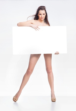 Young happy woman over white board photo