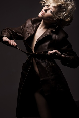 High fashion model in coat posing  Stock Photo - 9512887