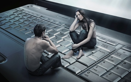 Conceptual photo of a couple sitting on laptop photo