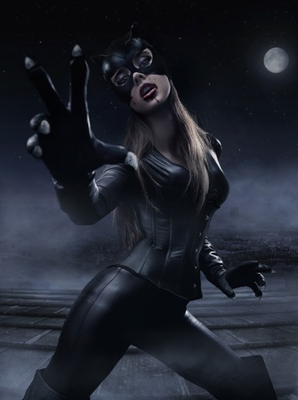 catwoman: Foggy photo of a woman wearing cats costume