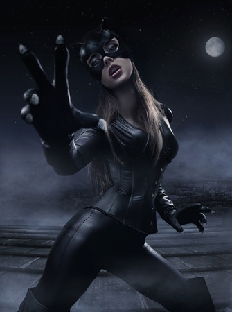 catwoman: Beautiful young woman wearing black suit