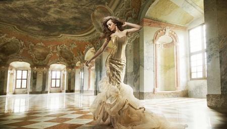 Fine art photo of a young fashion lady in a stylish interior Standard-Bild