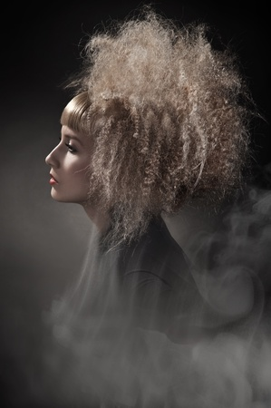 Smoky photo of a woman with gorgeous hair photo