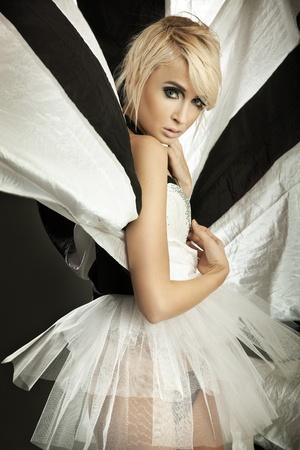 Amazing blonde girl in beautiful dress Фото со стока