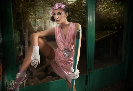 avantegarde: Young pretty fashionable cleaner in pink dress