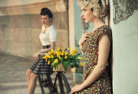 gorgeous women wearing retro clothes Standard-Bild