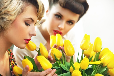 Two flower nymphs and a bunch of tulips Stock Photo - 9610871
