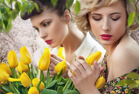 Two beautiful ladies in a tulip garden Stock Photo - 9610873