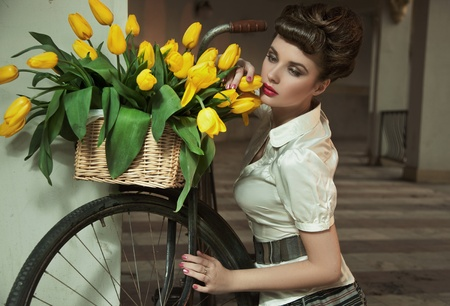 Beauty brunette with bunch of flowers photo
