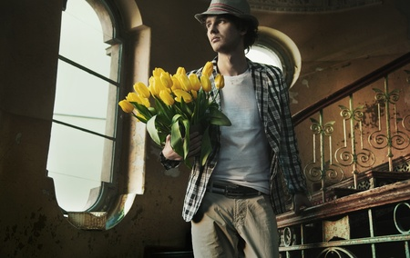 Romantic man holding bunch of tulips photo