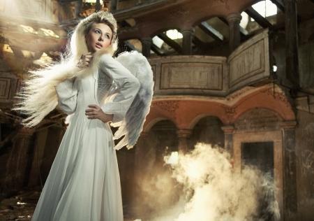 black angel: Cute blondie as an angel posing