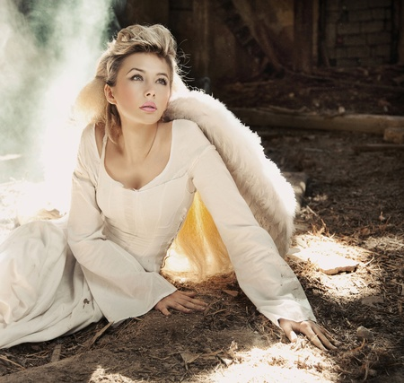 cleavage: Beautiful blond angel woman sitting