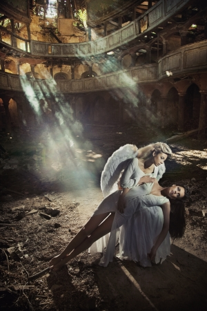 Two beautiful angel women posing photo