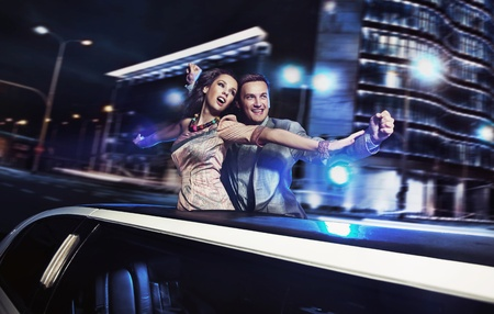 Smiling couple over night city background photo