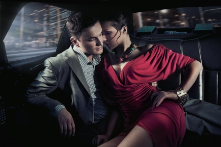 Sexy sitting couple in car photo