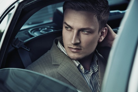 Handsome man in car Stock Photo - 9680844