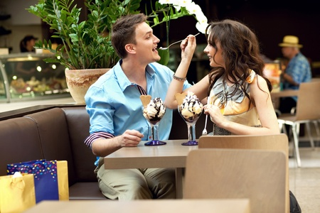food court: young couple enjoying ice cream Stock Photo