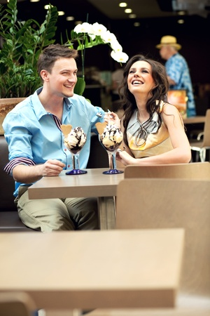 ice cram: Smiling couple at the cafe Stock Photo