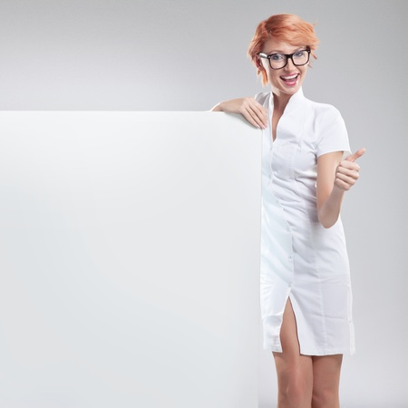Happy smiling woman with white board photo