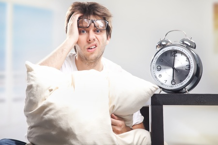 Angry man at the morning and the clock Stock Photo - 9831303
