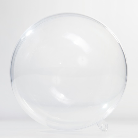 Empty glass ball on the white background photo