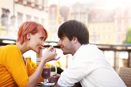 Cute young couple eating lunch photo