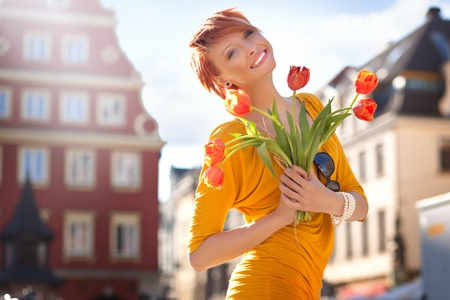 Happy woman with bunch of flowers photo