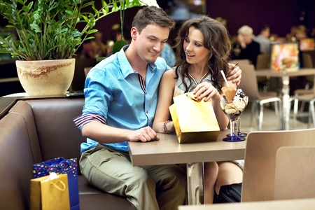 happy young couple, a man gives a present to his wife Stock Photo - 9831315