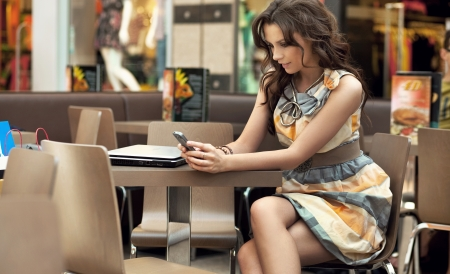 attractive woman waiting for someone at the restaurant table photo