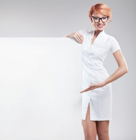 Woman wearing white coat with empty board Stock Photo - 9831299