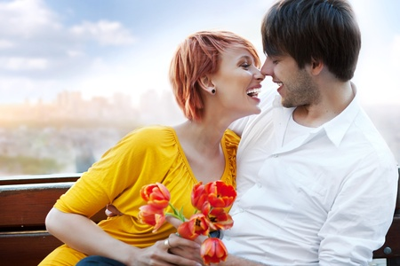 Young happy smiling attractive couple together outdoors photo